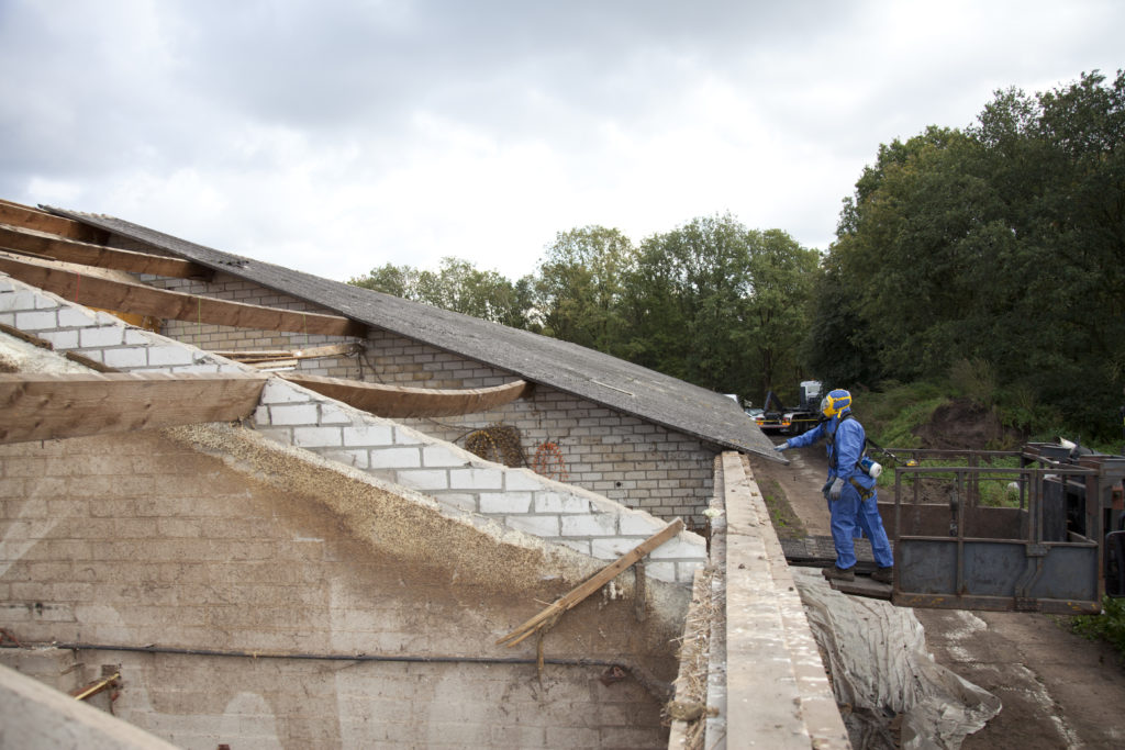 Asbestos roof removal and clean up in progress